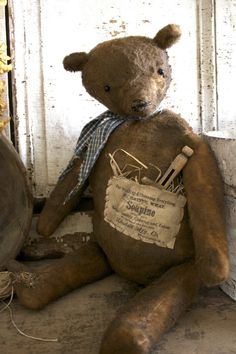 Sweet Old Teddy...with a grungy pocket & pin.