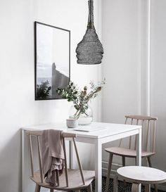 A white Swedish apartment with warm natural textures.