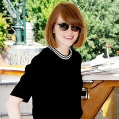Emma Stone At the Venice Film Festival, Emma Stone elevated a pair of gray sweats with a structured stripe-neck textured top...