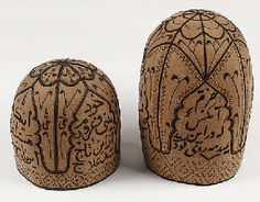 A conical hat of white felt, embroidered in black silk with Sufi inscriptions within pointed cartouches, the crown with a flower-shaped medallion--11in. (28cm) high; and a smaller conical hat, similarly worked--7½in. (19cm) high, Dervish, early 20th century Battle Of Karbala, African Hats, Indian Costumes, Persian Motifs, Sufi, The Crown, Headgear, Black Silk, Islam