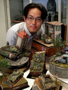 Japanese hobbyist Satoshi Arakis creates painstakingly-detailed dioramas at an incredible 1/32 and 1/35 scale. And, what's even more impressive is that he does all of this work at night, after he's done with his day job. Arakis constructs and paints objects that fit in the palm of your hand, and he builds complex scenes that fit on a tabletop.