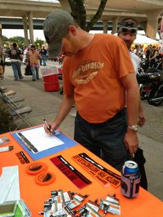 Harley-Davidson fans sign up for the Biker Newsbrief during the Harley-Davidson 110th Anniversary Party in Milwaukee, Wisconsin.  Sign up.    #milwaukee #harley #motorcycle #hd110