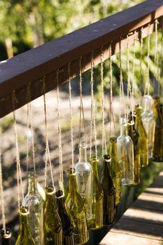 Creative hanging bottle decor, photo by Belathee Photography | via junebugweddings.com
