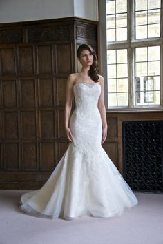 Maria - Sleek and elegant, this mermaid style wedding gown features a lovely lace that fades out towards the hem. The back of the gown dips down to a wide V shape. A pretty lace scallop trims the sweetheart neckline front and back.
