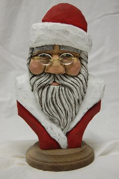Hand Carved Wood Santa Bust by TPOriginals on Etsy, $140.00 She does beautiful work!