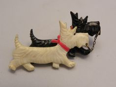 BLACK & CREAM CELLULOID / PLASTIC SCOTTIE DOGS BROOCH