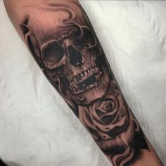 Image result for rose and skull tattoo forearm