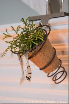 Cute+Bedspring+planter+on+a+Christmas+mantel