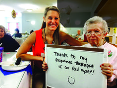 FOX client Mary Brzostek, 85, is all smiles about eating safely again, thanks to clinically excellent therapy from FOX clinician Kayla Triplett, OT, at Commonwealth Assisted Living at Hampton, a FOX Optimal Living partner.