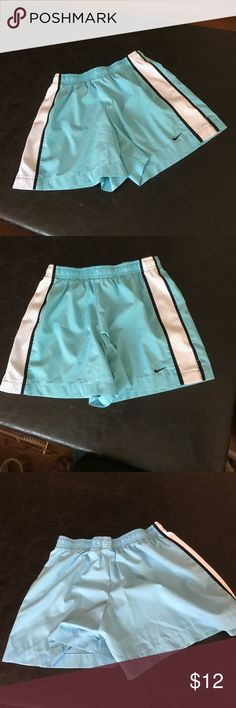 Nike light blue & white running shorts XS Nike light blue & white sides with black trim running shorts XS. Never been worn. In perfect condition. Nike Shorts