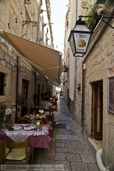 Dubrovnik alley old town by pixelwhip, via Flickr. Dubrovnik is full of these great alleys in which to eat.