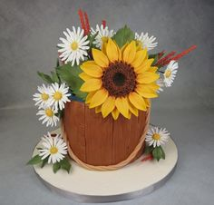 Sunflower & Daisies In Bucket Cake Mbalaska sugar flowers & leaves, fondant wood grain bucket, white cake with Swiss. Sunflower Birthday Cakes, Sunflower Cakes, Smash Cake First Birthday, Adult Birthday Cakes, Fondant Cakes, Cupcake Cakes, Artist Cake, Cake Decorating Frosting, Daisy Cakes