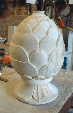The basic leaf shapes are roughed out. - pineapple rough carved, carving rough work, pineapple carving