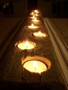 Awesome table centerpiece for candelight...using an old weathered piece of barn wood and drilled holes and tealights.