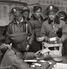 Tuskegee Airmen receiving rations, Italy, 1945