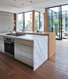 Mid century modern railings kitchen contemporary with oak floors modern atrium calaccatta countertop