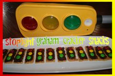 Stoplight Graham Cracker Snacks – graham crackers, chocolate frosting, red, yellow and green M&M's.  You could also put them on a popsicle stick with a dab of chocolate frosting as the glue! :-)  The kids have a blast making their own!!