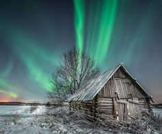 Aurora borealis over an abandoned cabin. Location and photographer unknown #hearthandtimber