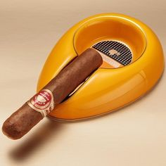 Enjoy a cigar in style with this Cohiba Ceramic ashtray. This beautiful glazed ceramic ashtray has the Cohiba logo in gold lettering. This single cigar ashtray Black Sea, Yellow Black, Cohiba Cigars, Cigar Holder, Cigar Ashtray, Zippo Lighter, Glazed Ceramic, Garden Trowel, Household