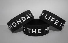 """I Live The Monday Life"" debossed 1 inch silicone bracelet with white print. Silicone Bracelets, Clothing Logo, Custom Logos, Live, Inspiration, Black, Biblical Inspiration, Black People, Inspirational"