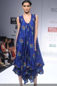 Femina Miss India World 2011 Kanishtha Dhankhar showcases a creation by designer Shruti Sancheti on Day 5 of Wills Lifestyle India Fashion Week (WIFW) autumn-winter (AW) 2014, held in Delhi, on March 30, 2014.