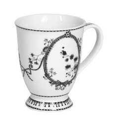 Sophisticated white and black dinnerware collection mixes modern femininity, high fashion and enchanting illustrative floral designs. Miss Blackbirdy coffee mug. #black #white #coffee