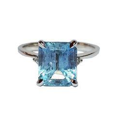 14 Karat White Gold 1 Emerald Cut Aquamarine: 2.67 cttw 2 Round Brilliant Cut Diamonds: 0.06 cttw VS Clarity & G Color Size 6 Stock #200-2000328