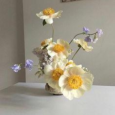 Understated floral arrangement with purple and yellow flowers. My Flower, Flower Art, Beautiful Flowers, Deco Floral, Arte Floral, Bonsai Plante, Floral Wedding, Wedding Flowers, No Rain