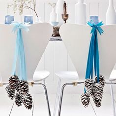 Pinecones-and-Ribbon Decoration: hot-glue blue velvet ribbon to frosted pinecones, tie a bunch together and hang from doors, chairs or mantels.