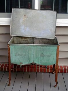 It's some sort of old double wash tank. Has drain spigots on each side of the tank and a lid. Made by Ideal Manufacturing Co. in Saginaw, Michigan.