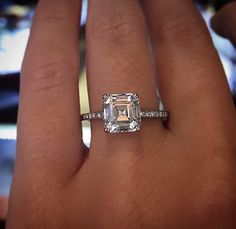 Asscher cut diamond engagement ring with less visible prongs