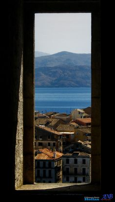 Seeing the Corfu Island through a window - Kerkyra (Greece) by Athanasios Benisis