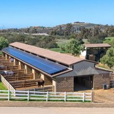 love this idea for each horse to have their own outdoor area connected to the stalls, but want it to be larger. also love the solar panels