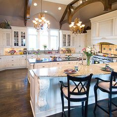 Love this kitchen layout. Love the island. The amazing stove and the eating bar.