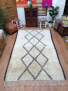 Beniouarain Carpet is the home of handmade imported carpets and rugs from Morocco. With all the carpets, area rugs, pillows and additional nomad treasures that we carry, let our home reflect the look of your home. Berber Rug, Prehistoric, Rugs On Carpet, Shag Rug, Bohemian Rug, Hand Weaving, Area Rugs, Pillows, Moroccan