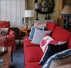 Every cottage needs a red sofa!