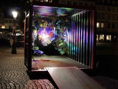 Diffraction by Etienne Rey & Laurent Le Bourhis....  Installation made of suspended acrylic squares that plays with light....