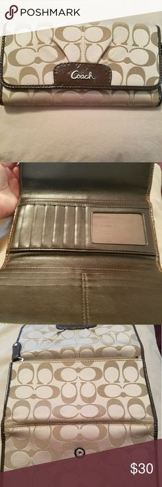 Coach wallet Like new Coach wallet. Has 12 card slots and 3 bill compartments. Coach Bags