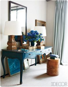 Paint One Piece. Choose a piece of furniture in your house and paint it that color that speaks to you, like this beautiful desk painted an intense peacock blue.    Elle Decor