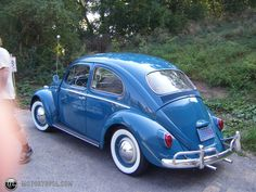 Volkswagen Beetle - Sister Chan had one in red, don't remember the year in the 60's