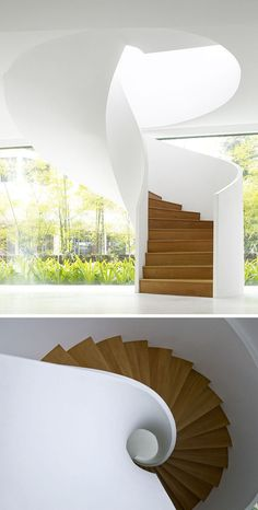 The smooth appearance of this modern white and wood spiral staircase makes it look like it could have simply twisted down from the ceiling.
