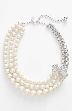 Dressing up a fit & flare dress with this Kate Spade faux pearl and crystal multistrand necklace.