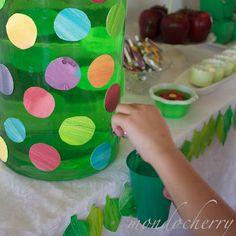 Hungry caterpillar party....A leaf garland was created for along the front of the table from more painted card, stitched together. Punched holes made it look as though a caterpillar had nibbled through them...