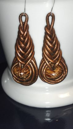 Pipa knot leather earrings by ZuriAkachi on Etsy