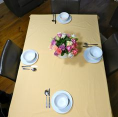 Tablecloth and Fairtrade flowers - the tablecloth is made with our Fairtrade certified cotton fabric in Yellow Gingham.  A special breakfast setting for Fairtrade Fortnight #fairtradefortnight #fairtrade #youeattheyeat #cotton #yellow www.fairtradefabric.co.uk