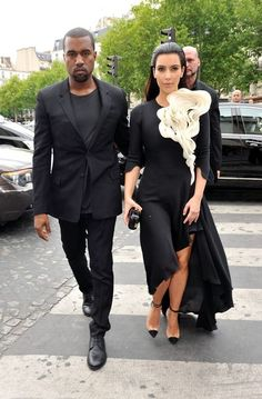 Kim Kardashian and Kanye West go to dinner at L'Avenue restaurant and bump into Melanie 'Mel B' Brown and Stephen Belafonte while in town to attend shows during Paris Fashion Week.