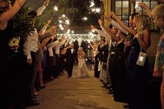 PLEASE REPIN! Kate and Blaine - I loved seeing how excited our guests were to use the sparklers. It was such a unique way to exit the wedding. Oklahomans love fireworks on warm summer days anyways so following a black tie event made it extra special. -  Lisa S. Dunham Photography