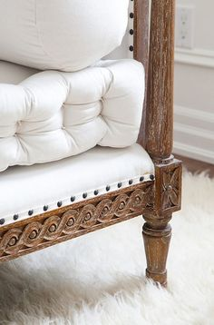 white linens, carved brown bed frame