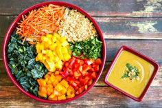 superfood thai salad with a delicious coconut-curry dressing. Ingredients: 1 can low-fat coconut milk 1/4 cup creamy peanut butter 1 tablespoon yellow curry powder 1 clove garlic juice of a lime 1-2 teaspoons sriracha 1 teaspoon kosher salt (or to taste) 3 cups chopped kale 2 cups chopped napa cabbage 1 red bell pepper, chopped 1 cup shredded carrots 1 cup chopped mango 1/2 cup chopped peanuts 1/2 cup chopped cilantro