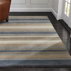 Easy-to-live-with neutrals stripe deep and rich on this 100% wool rug, loom-woven by skilled artisans. Subtle variations in color create décor-friendly depth and interest.
